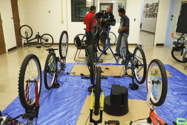 Burleson Center using Dos Calles Bike Shop to build skills, inroads with SAPD