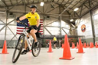 436th SFS pedals to strengthen community relations