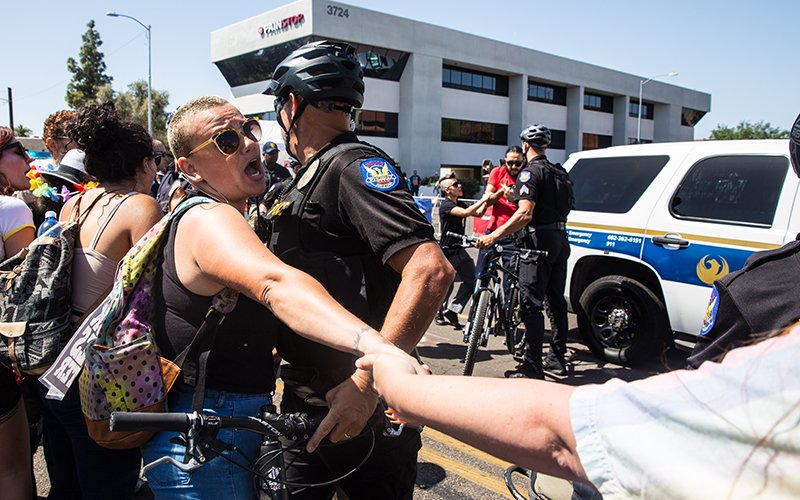 Undocumented LGBTQ protesters clash with Phoenix police at Pride parade, vow to hold own event