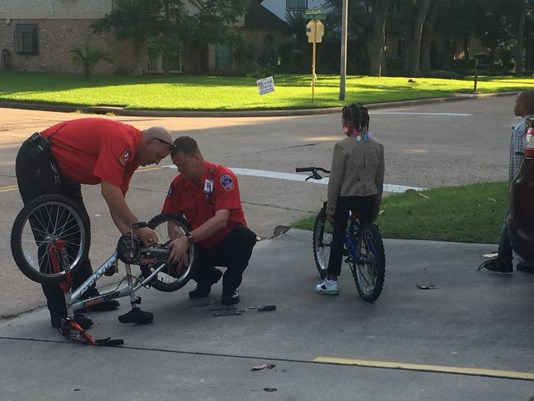 Kind moment: Cypress Creek EMS medics help fix boy's bike