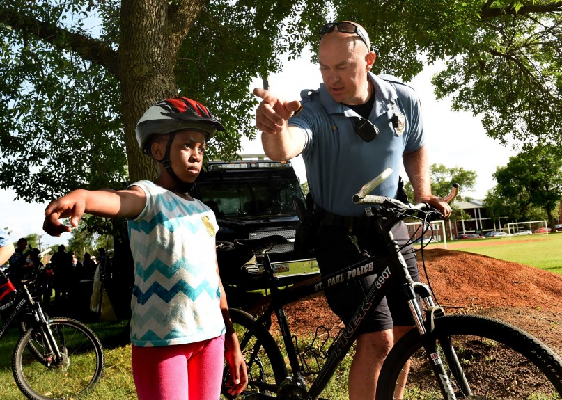 A bike trailer full of free helmets keeps kids safe — and connects them with cops