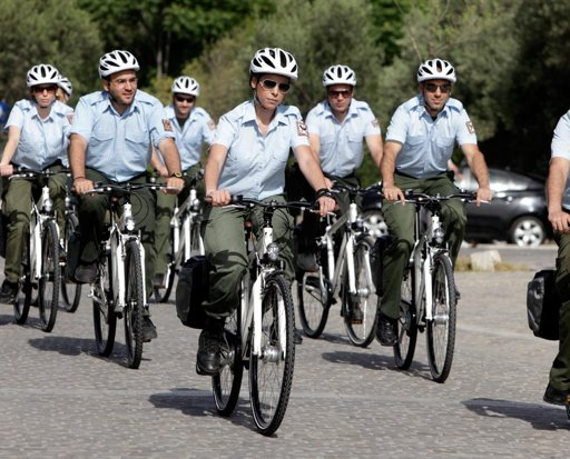 Greek police officers on bikes greet tourists at historic center of Athens