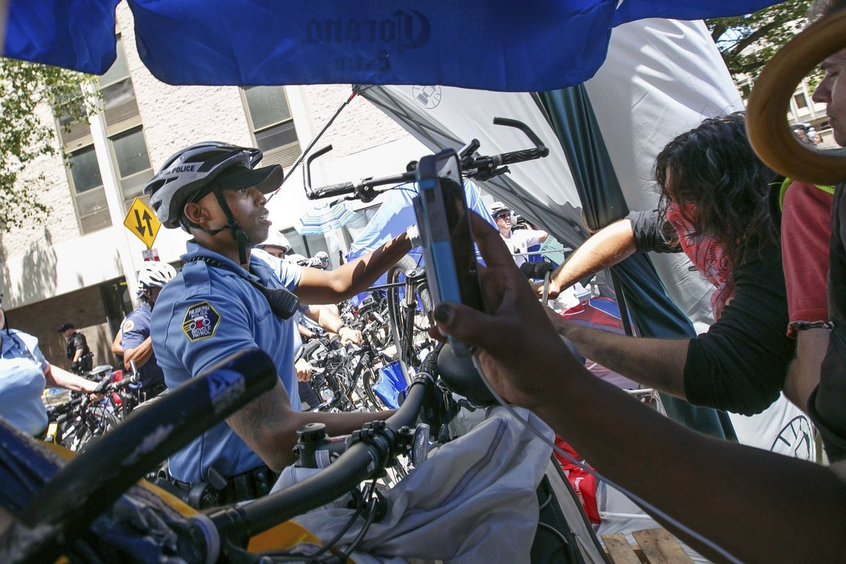 Cops with bikes: A way to engage the community or a tactic to bulldoze them?