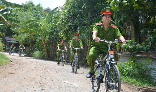 In Vietnam, police patrol on bicycles to build rapport with residents
