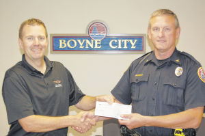 Classic Instruments makes donation for police bike patrols