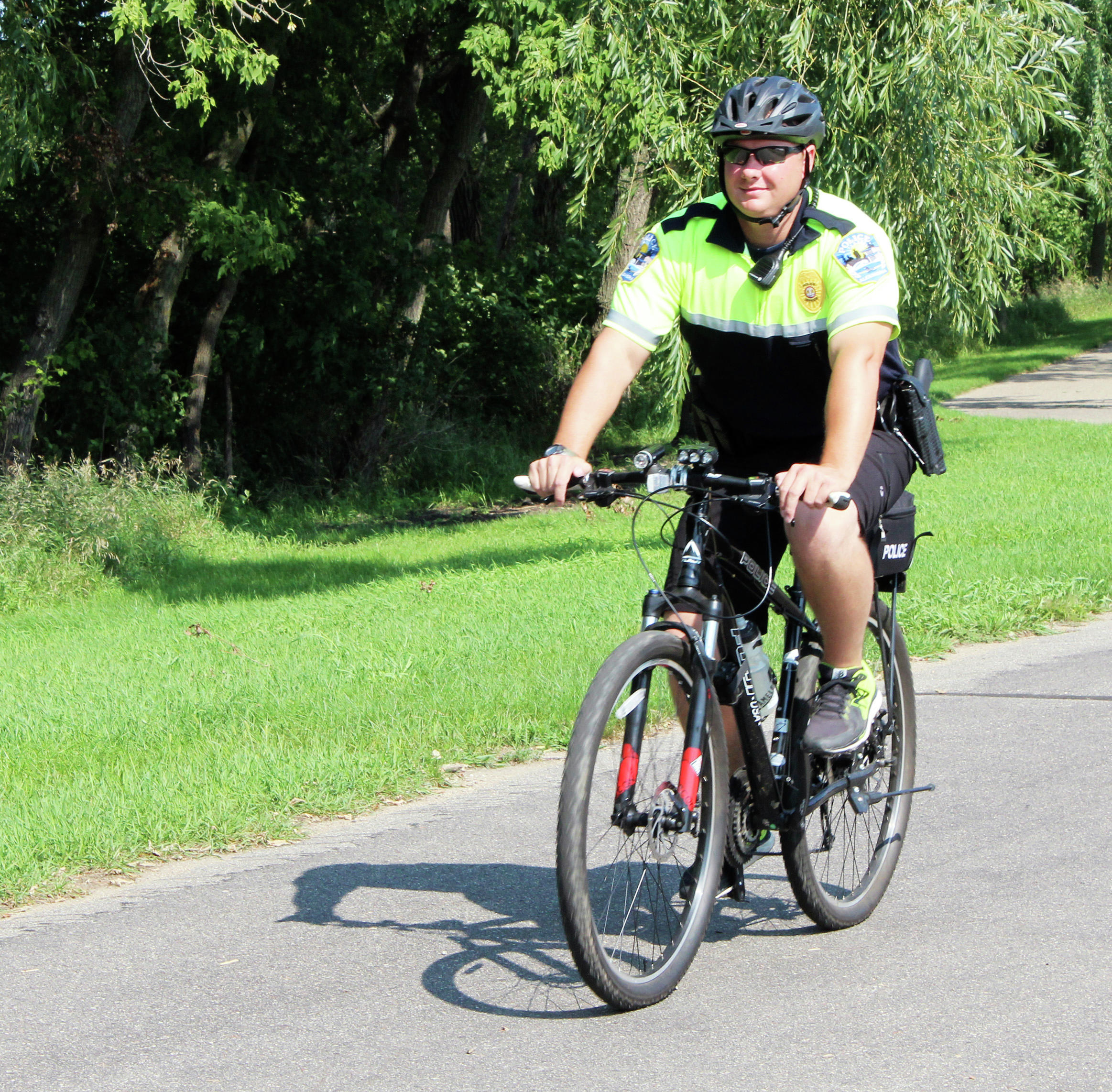 Police with pedals promote safety on bike trail