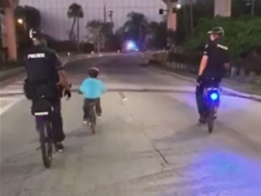 Boy finishes onbikes charity ride with Tampa police by his side