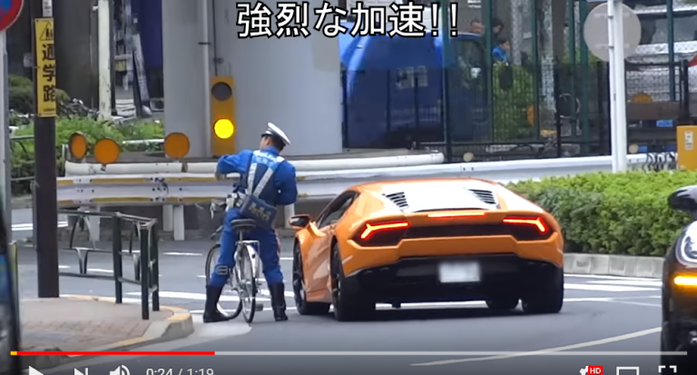 Japanese police officer pursues, pulls over Lamborghini supercar…while on a bicycle