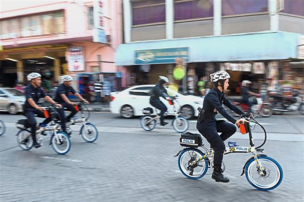 Penang police to patrol busy streets with e-bikes
